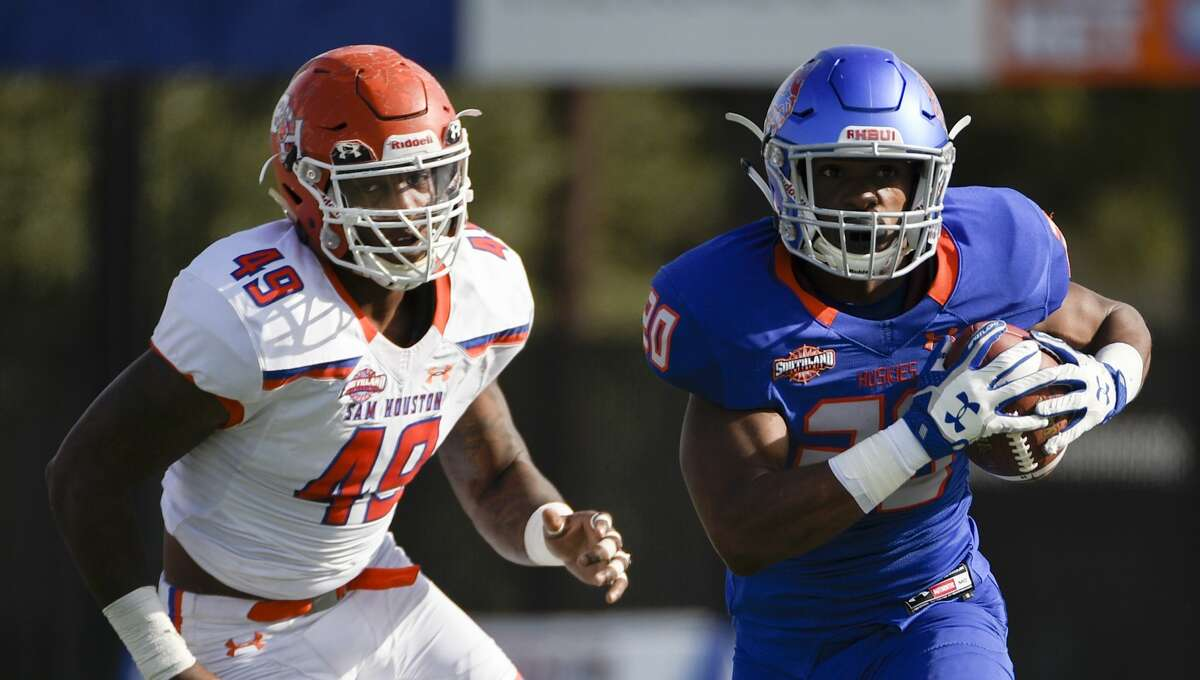 PHOTOS: NFL's best available free agents Houston Baptist running back LaDarius Dickens, right, rushes past Sam Houston State defensive end Derick Roberson during the first half of an NCAA college football game, Saturday, Nov. 17, 2018, in Houston. (Eric Christian Smith/Contributor) >>>See which players remain available ...