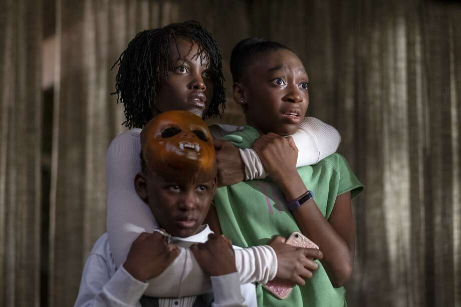 "From left, Evan Alex, Lupita Nyong'o and Shahadi Wright Joseph in a scene from ""Us,"" written, produced and directed by Jordan Peele. Photo: Claudette Barius / Associated Press / © Universal Pictures"