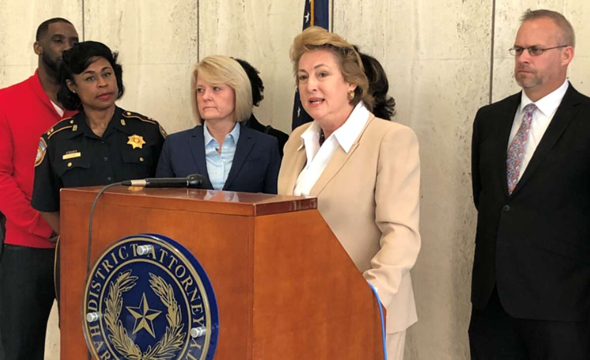 Harris County District Attorney Kim Ogg, at lecturn, said fewer people have been arrested since a program to divert low-level marijuana offenses out of the court system was begun two years ago.