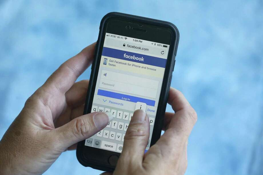A Facebook start page is shown on a smartphone in Surfside, Fla. Photo: Wilfredo Lee / Associated Press / Copyright 2018 The Associated Press. All rights reserved.
