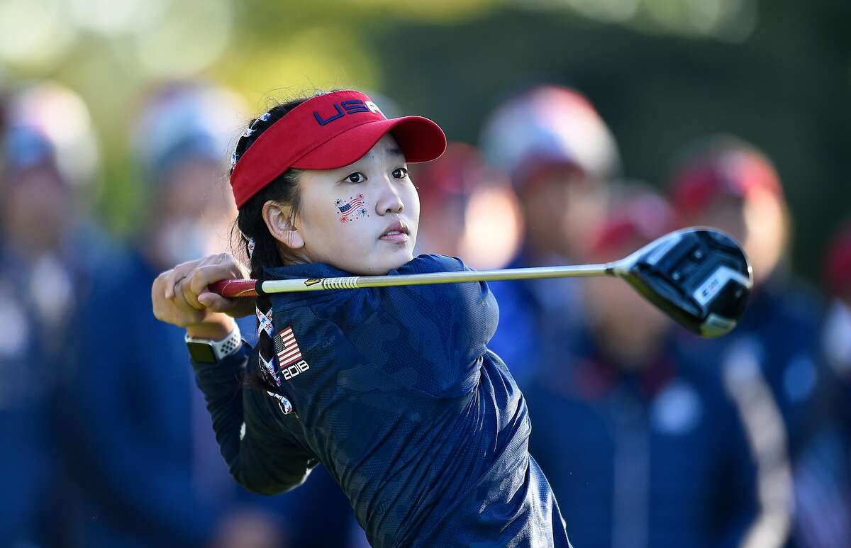 PARIS, FRANCE - SEPTEMBER 25: Lucy Li of Team USA tees off during the singles on day two of the 2018 Junior Ryder Cup at Disneyland Paris on September 25, 2018 in Paris, France. ~~