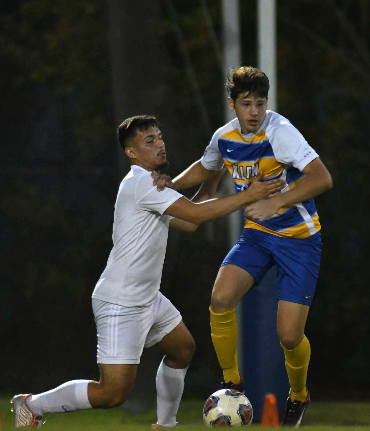 Klein junior defender Giuliano Maceroni, right, works for the ball against Westfield senior midfielder Jose Alarcon during the first half of their Region II-6A Bi-District Soccer Playoff match at Klein High School on March 28, 2019.