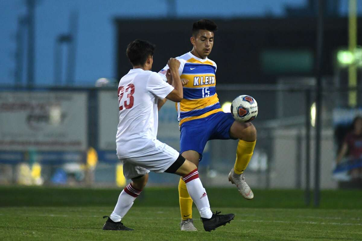 Klein sophomore midfielder Luis Ayala (15) controls the ball against Westfield freshman forward Rony Andrade (23) during the first half of their Region II-6A Bi-District Soccer Playoff match at Klein High School on March 28, 2019.