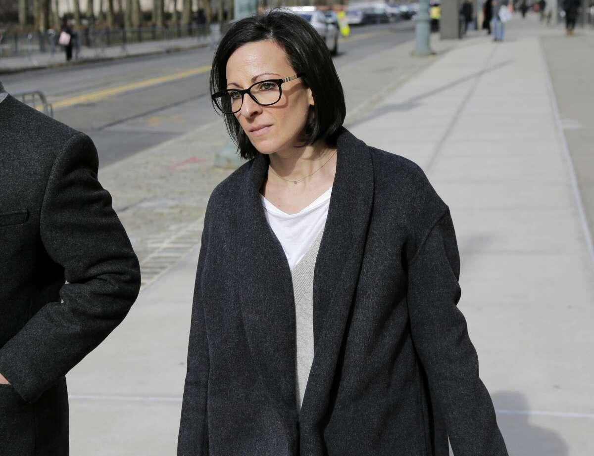 Lauren Salzman leaves Brooklyn federal court in New York, Monday, Jan. 28, 2019. (AP Photo/Seth Wenig)
