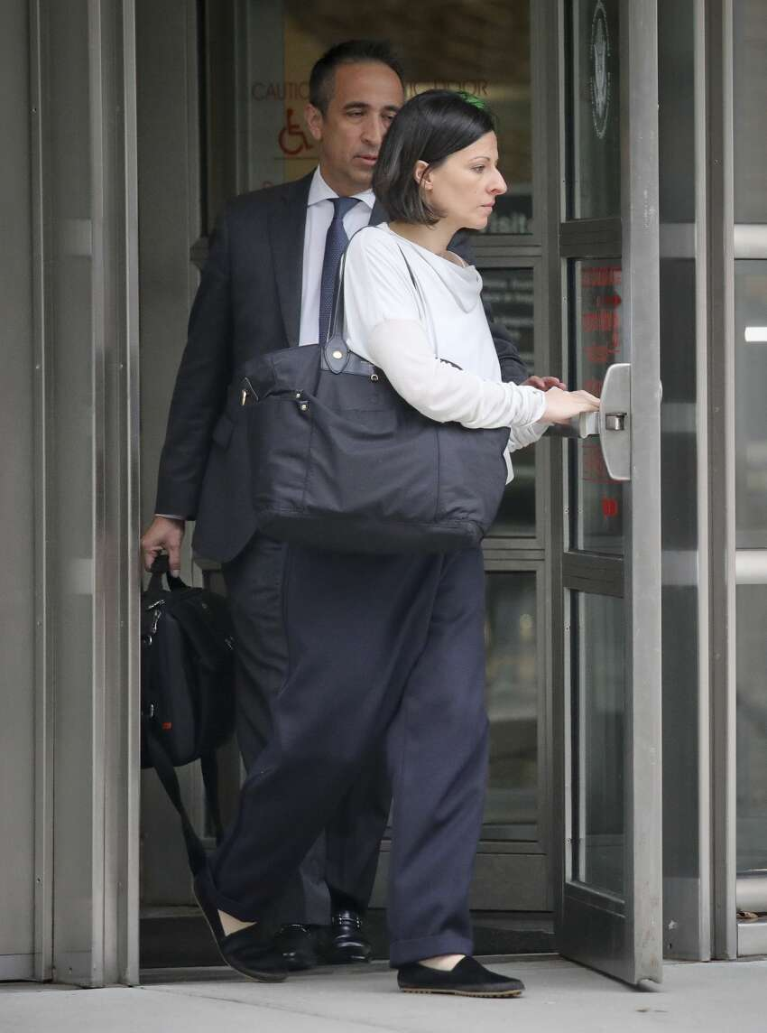 Lauren Salzman leaves Brooklyn Federal Court, Thursday Oct. 4, 2018, in New York. Salzman is among defendants from the self-help group NXIVM, co-founded my her mother Nancy Salzman, charged with coercing women to be a part of a secret sub-group where they were expected to act as