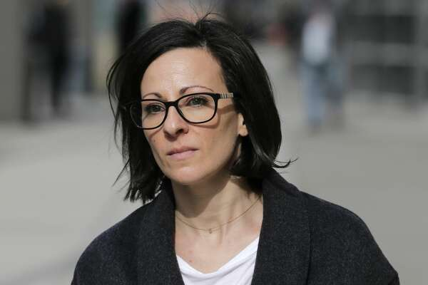 Lauren Salzman leaves Brooklyn federal court in New York, Monday, Jan. 28, 2019.When she pleaded guilty on March 25, Salzman admitted that she had recruited women into a secret slave-master club founded by Raniere and had threatened to release damaging information about those women if they did not perform tasks or tried to leave the group. (Associated Press / Seth Wenig)