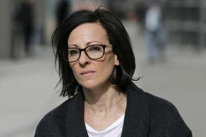 """Lauren Salzman leaves Brooklyn federal court in New York, Monday, Jan. 28, 2019. Salzman is among defendants from the self-help group NXIVM, co-founded my her mother Nancy Salzman, charged with coercing women to be a part of a secret sub-group where they were expected to act as """"slaves"""" and engage in sex acts. (AP Photo/Seth Wenig)"""