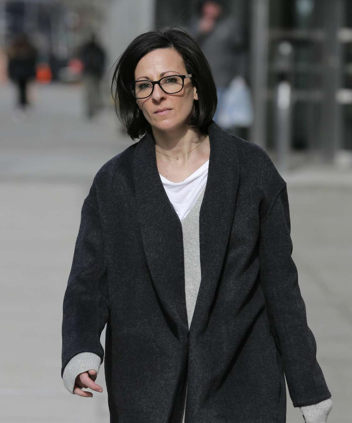 Lauren Salzman leaves Brooklyn federal court in New York, Monday, Jan. 28, 2019. Salzman is among defendants from the self-help group NXIVM, co-founded my her mother Nancy Salzman, charged with coercing women to be a part of a secret sub-group where they were expected to act as