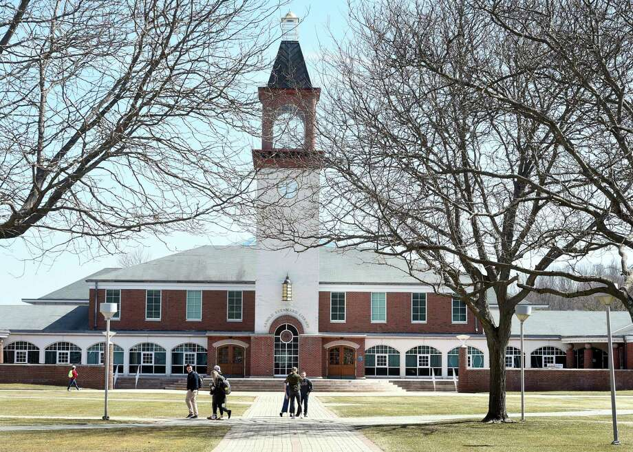 Students walk past the Arnold Bernhard Library at Quinnipiac University in Hamden in 2019. Photo: Arnold Gold / Hearst Connecticut Media / New Haven Register