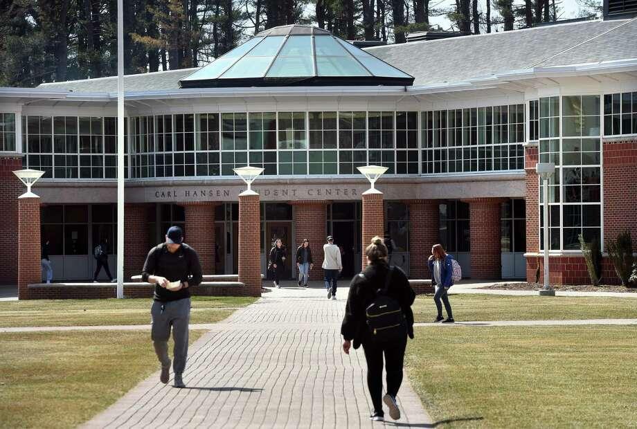 Students walk past the Carl Hansen Student Center at Quinnipiac University in Hamden on March 28, 2019. Photo: Arnold Gold / Hearst Connecticut Media / New Haven Register