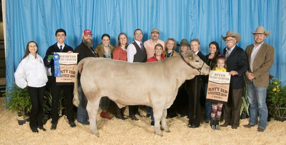 Mikaela Flenner raised the grand champion steer which sold at the Katy ISD FFA Livestock auction for $21,000.