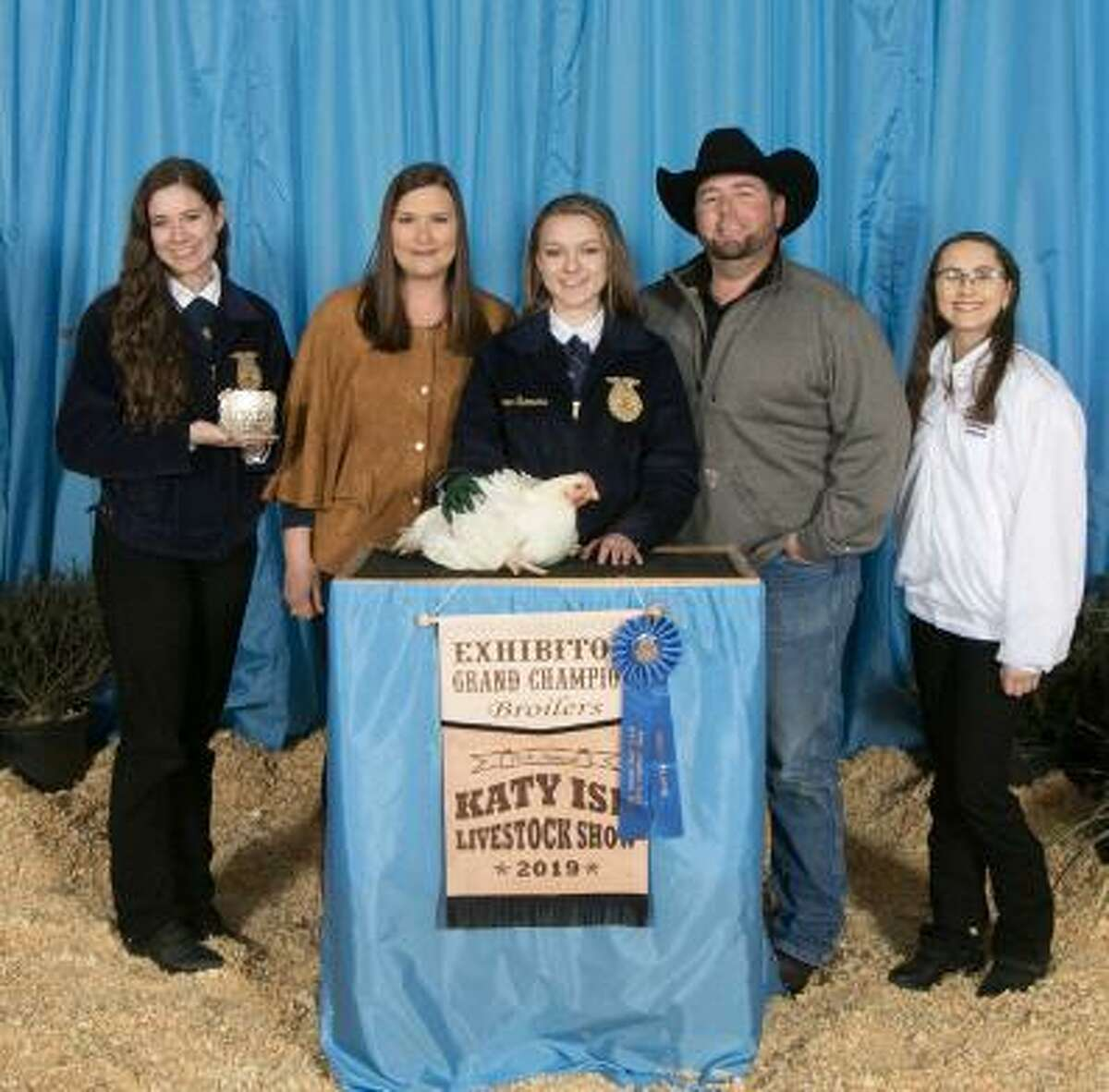 Lauren Summers raised the grand champion broilers which sold at the Katy ISD FFA Livestock auction for $7,000.