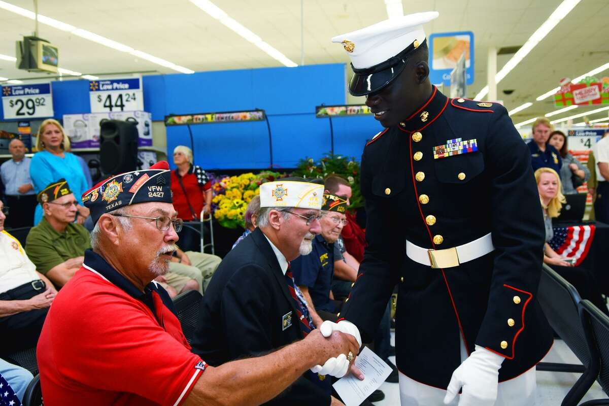 Tomball Memorial ROTC members shake hands with veterans during Veterans Day events at the Tomball Wal-Mart on Nov. 11.