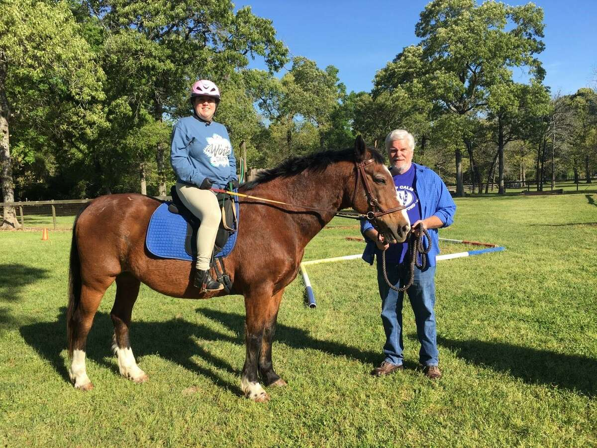 SIRE volunteer Don Pages works with Shelby Day at the SIRE facilities in Hockley.