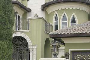 McMansions are defined by a mishmash of architectural features.