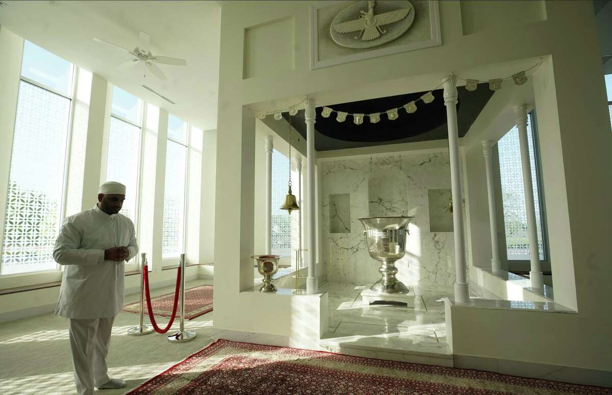 Zerkxis Bhandara, a Zoroastrian priest, stands at the sanctum at the Bhandara Atash Kadeh, 8787 West Airport Road, a Zoroastrian fire temple, Friday, March 22, 2019, in Houston. Zoroastrians, people who practice one of the world's oldest religions, will open their first full-fledged U.S. temple on Saturday in southwest Houston.