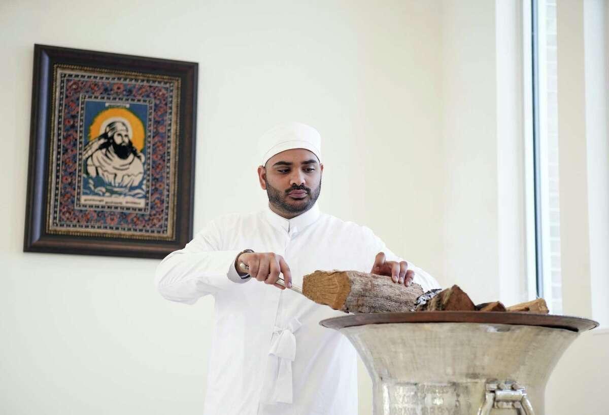 Priest Zerkxis Bhandara tends a fire at Houston's new Atash Kadeh.