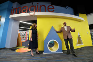 John Trischitti III, director of libraries, and Megan Buck, social impact and community engagement coordinator, show off new amenities at the downtown library March 26, 2019. James Durbin / Reporter-Telegram