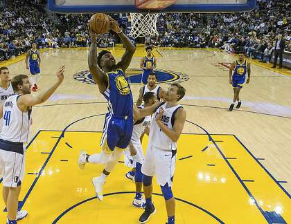 bc3431edc083 Golden State Warriors forward Jordan Bell (2) shoots against the Dallas  Mavericks in the second half of an NBA basketball game Saturday