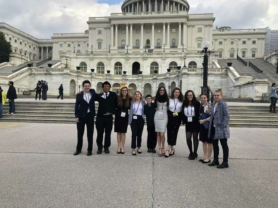 TEMPLE BETH DAVID YOUTH: Over the course of four days in March, 10 teens from Temple Beth David of Cheshire went to L'Taken, the Social Justice Seminar for Teens. In partnership with the Religious Action Center (RAC) of Reform Judaism, they had the opportunity to impact our country by sharing their views on social justice topics with decision-makers on Capitol Hill. Along with 200 teens from around the country, the Cheshire teens spent the weekend immersed in topics that stirred their interest and learned how to craft speeches, which they then presented to state Senate and Congressional offices. When they weren't working on their social action topics, they toured Georgetown, visited the Smithsonian, the Holocaust Museum and more and on Saturday evening attended havdallah services at the Jefferson Memorial. From left are Josh Koppel, Alex Math, Clara Shafer, Sara Deponte, Joey Kosover, Sydney Carim, Maya Kostolitz, Micayla Nann, Anna Curran and Samantha Alexander. Photo: Contributed Photo