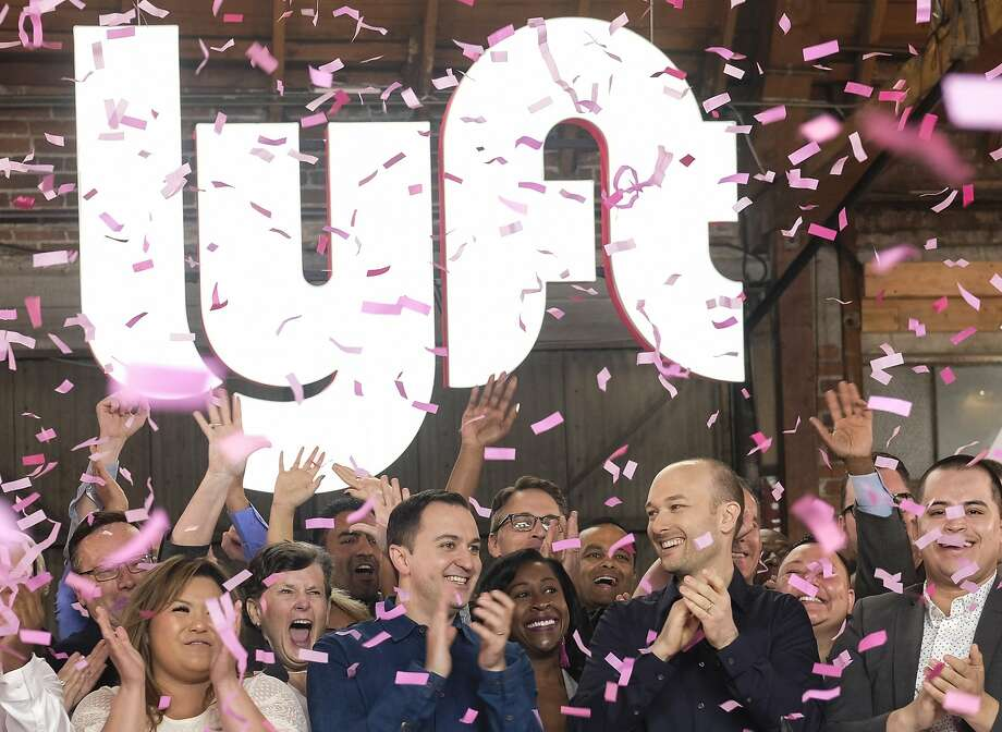 "Lyft co-founders John Zimmer, left, and Logan Green cheer as they ring a ceremonial opening bell in Los Angeles, Friday, March 29, 2019. On Friday the San Francisco company's stock began trading on the Nasdaq exchange under the ticker symbol ""LYFT.""  Photo: Ringo H.W. Chiu, Associated Press"