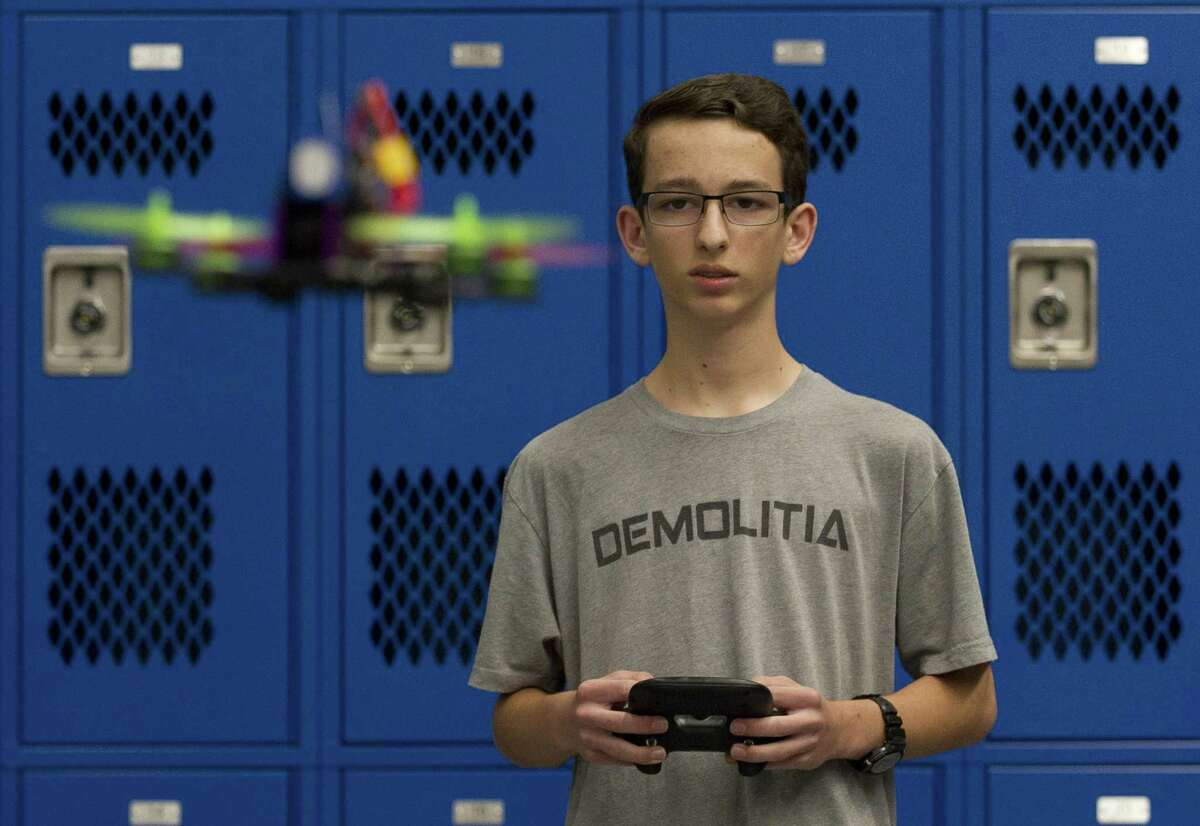 Ben Zufelt flies a racing drone he built during a meeting of Grand Oak High School's drone club, Tuesday, in Spring. Under the direction of teacher Tom Tanner, students learn how to build, fly, race and repair drones.