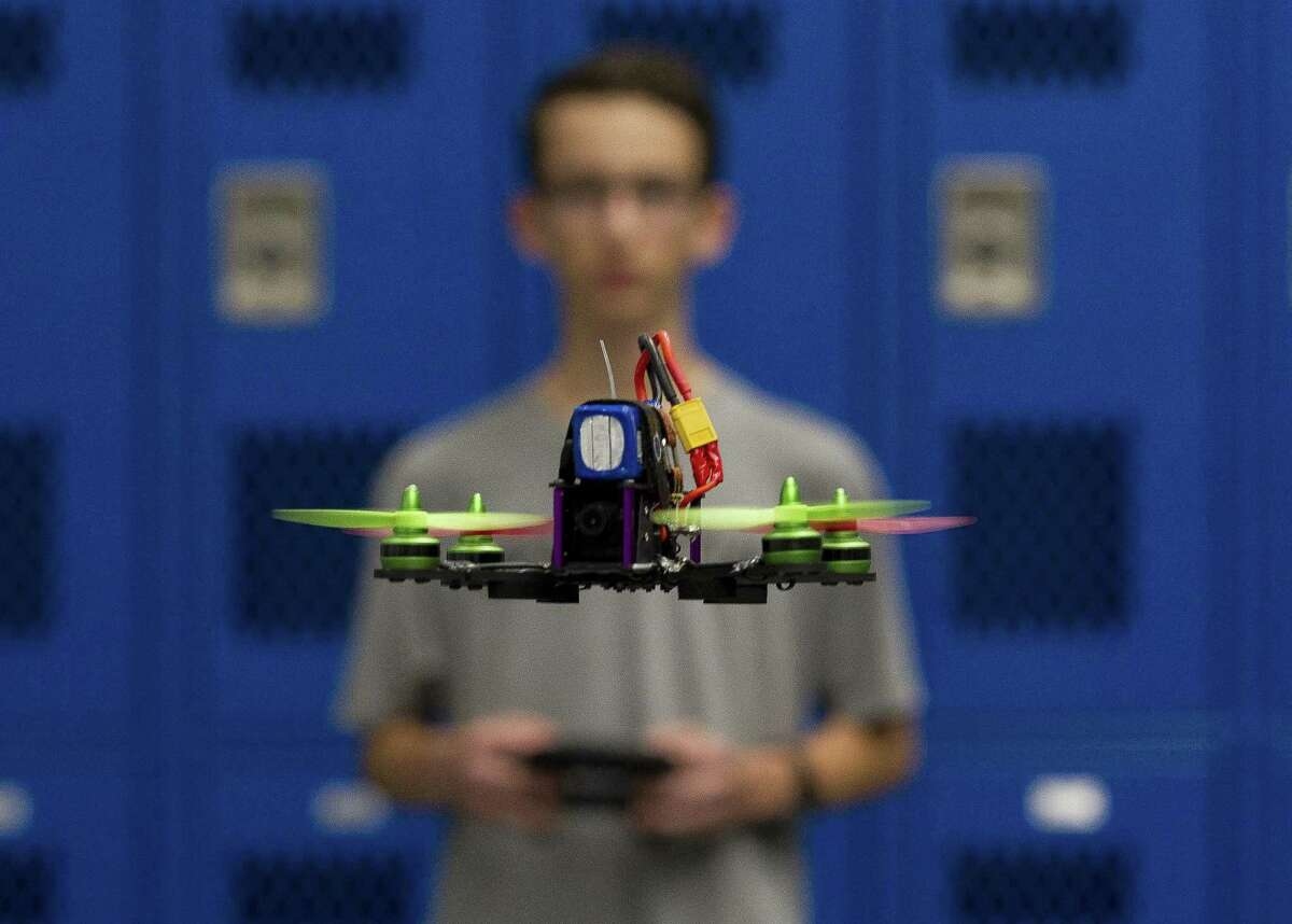 Ben Zufelt flies a racing drone he built during a meeting of Grand Oak High School's drone club, Tuesday, March 26, 2019, in Spring. Under the direction of teacher Tom Tanner, students learn how to build, fly, race and repair drones.
