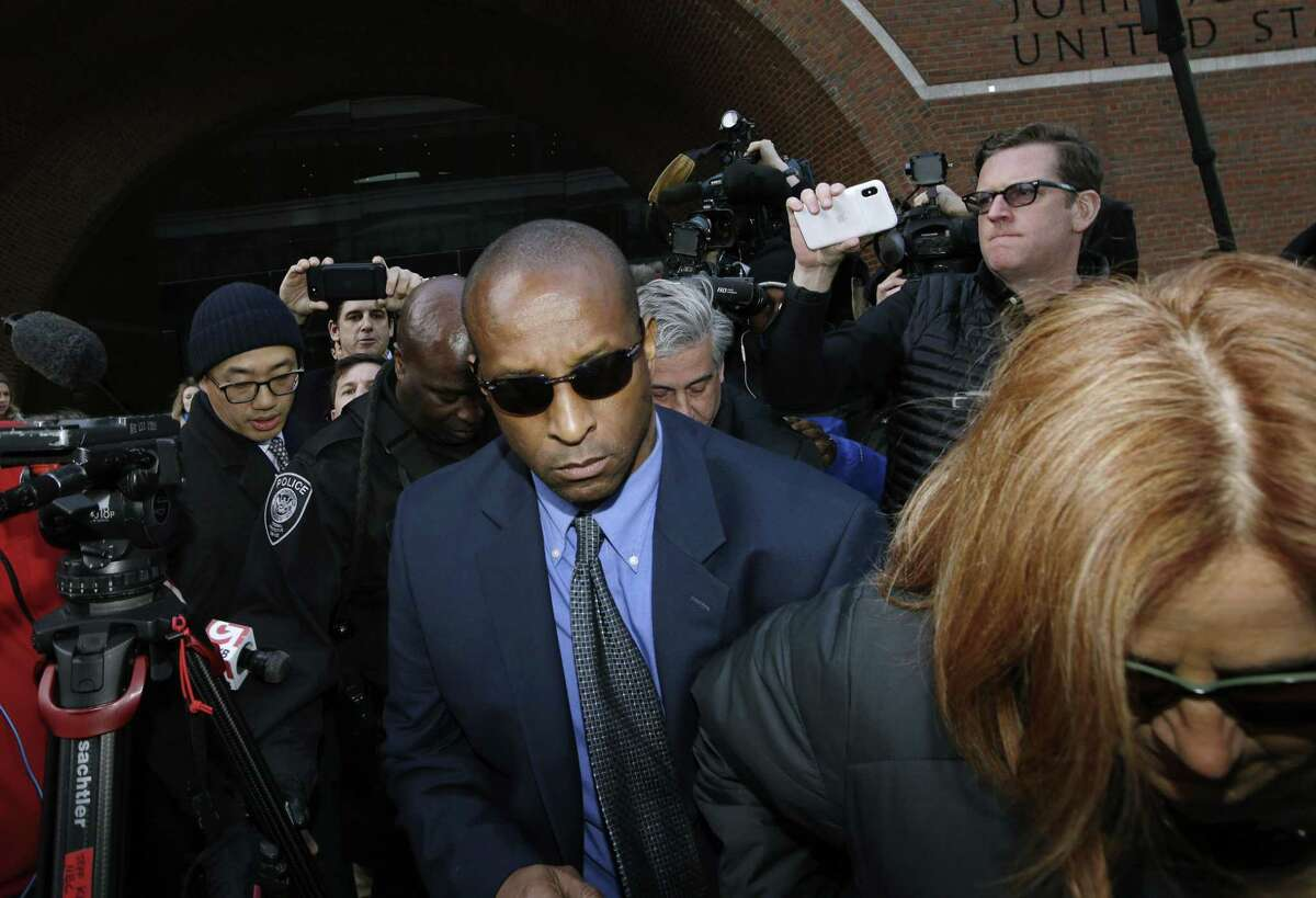 Rudy Meredith, former Yale women's soccer coach, departs federal court in Boston on Thursday, March 28, 2019, to face charges in a nationwide college admissions bribery scandal. (AP Photo/Steven Senne)