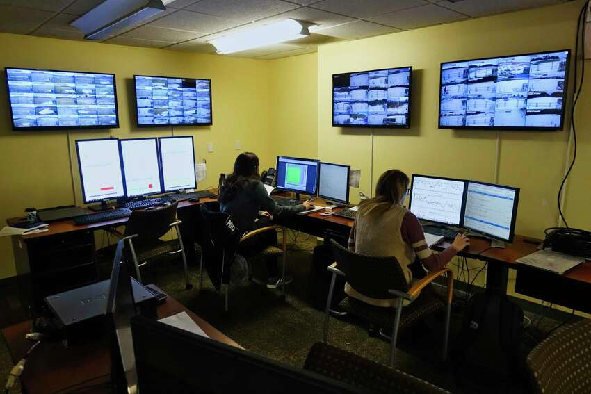 University at Albany atmospheric science department students, Christina Talamo, left, and Ashley Williamson, both juniors, work in the NYS Mesonet offices on Tuesday, Feb. 5, 2019, in Albany, N.Y. The two students monitor the information coming in from the measuring sites and aid field technicians who are performing maintenance or repairs on one of the measuring sites. (Paul Buckowski/Times Union)