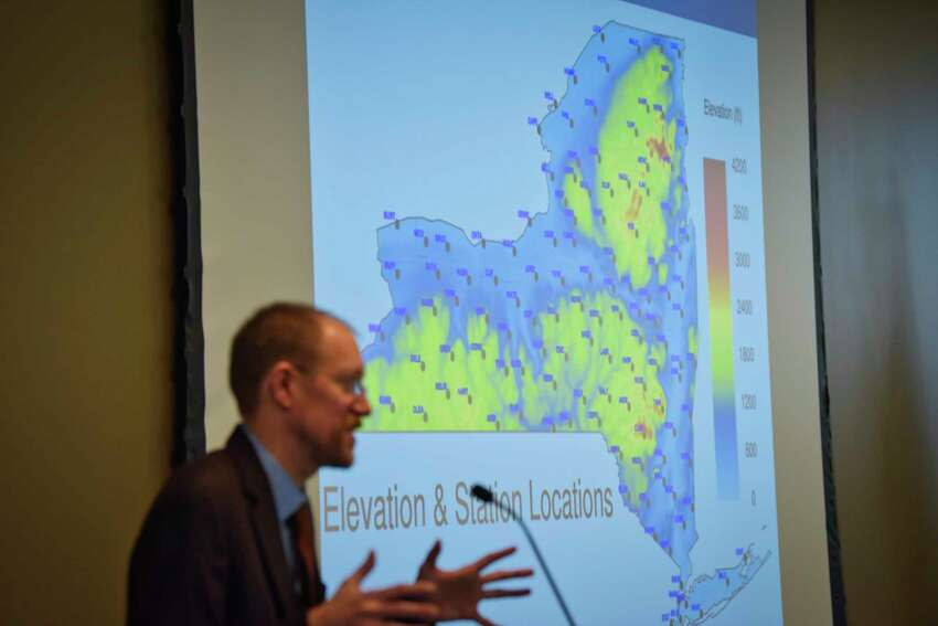 Jerry Brotzge, project director of the NYS Mesonet at the University at Albany, talks about the Mesonet system during a press event on Tuesday, Feb. 5, 2019, in Albany, N.Y. In the background on the screen is an image showing the locations of the measuring stations around the state. (Paul Buckowski/Times Union)