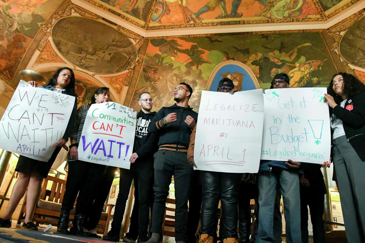 Vidal Guzman, center, an organizer with with a group seeking to cut the prison population, speaks during a news conference calling for marijuana legalization to be included in the state's budget, at the state capitol in Albany, N.Y., March 26, 2018. The collapse of an effort to legalize marijuana in New Jersey revealed the thorny and knotty difficulties in trying to legalize marijuana.