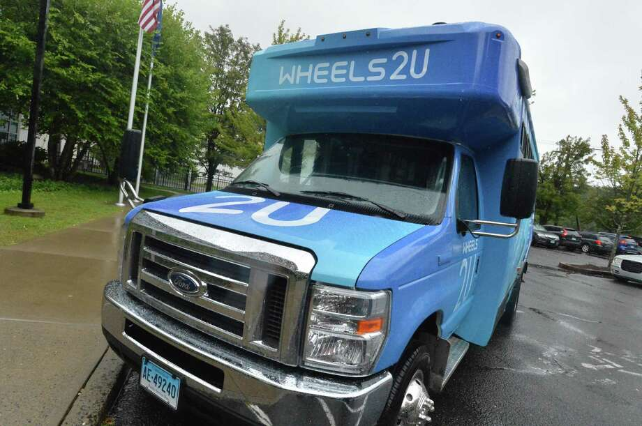 One of the new graphic wrapped buses as the Norwalk Transit District introduces its new MicroTransit on demand ride share buses Wheels2U. The pilot ride share program was extended for two months. Photo: Alex Von Kleydorff / Hearst Connecticut Media / Norwalk Hour