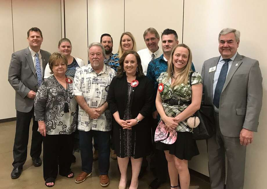 Last Wednesday the Conroe Noon Lions Club welcomed 14 new members, now making them the largest Lions Club in Texas. Pictured left to right front are - Janell Volke, Craig Moore, Elizabeth Anderson, April Clark, Past International Director Sam Lindsey; back - President Bobby Brennan, Katherine Appodaca, Justin Younger, Melissa Cain, Glenn Slater, David Clark. Photo: Courtesy Photo