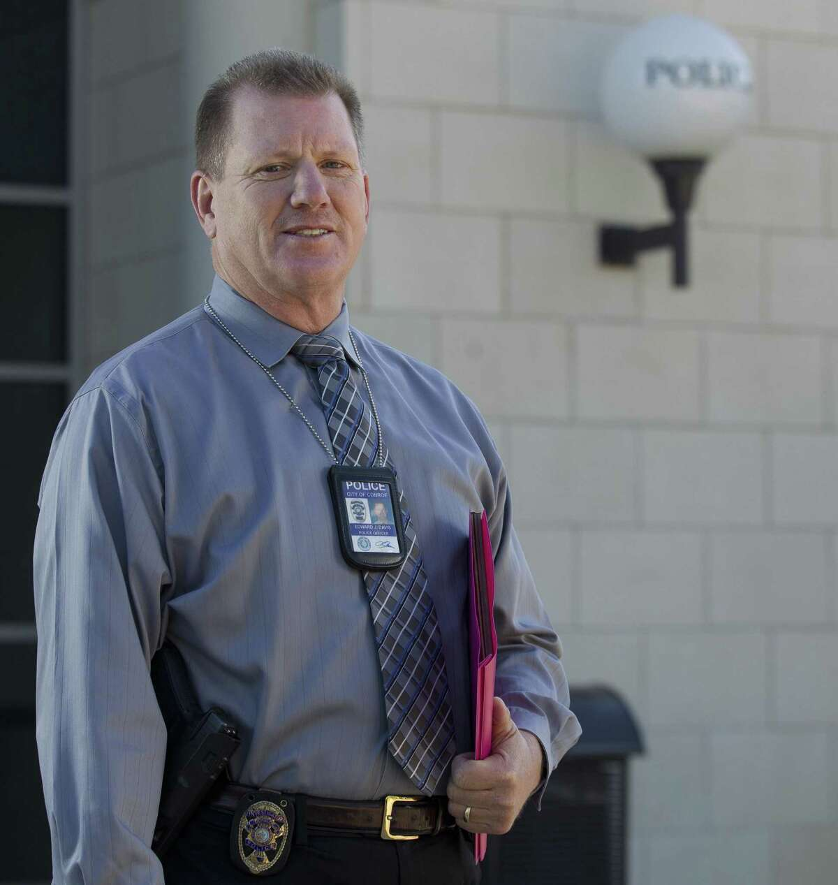 Edward Davis, a recruiter with the Conroe Police Department, poses for a portrait outside the department's headquarters on Plantation Drive, Thursday, March 21, 2019, in Conroe. Davis has been with the department for 30 years, serving 20 of those years as a detective.