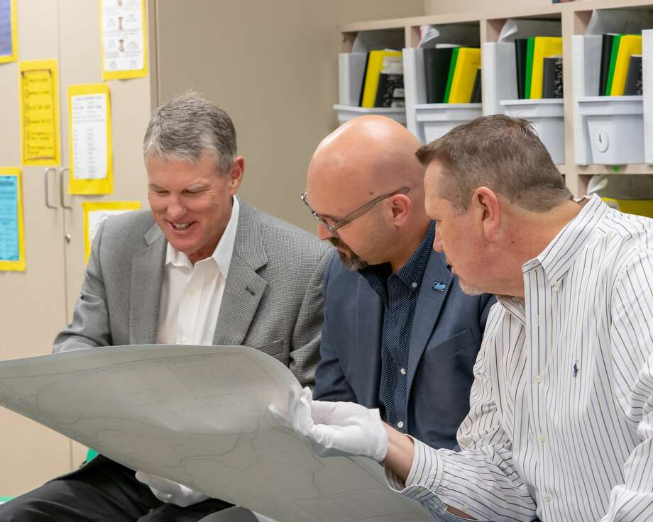 Midland ISD School Board of Trustees Rick Davis, from left, John Trischitti III and Bryan Murry analyze the historical map. Photo: Midland ISD