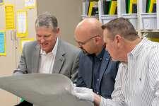 Midland ISD School Board of Trustees Rick Davis, from left, John Trischitti III and Bryan Murry analyze the historical map.