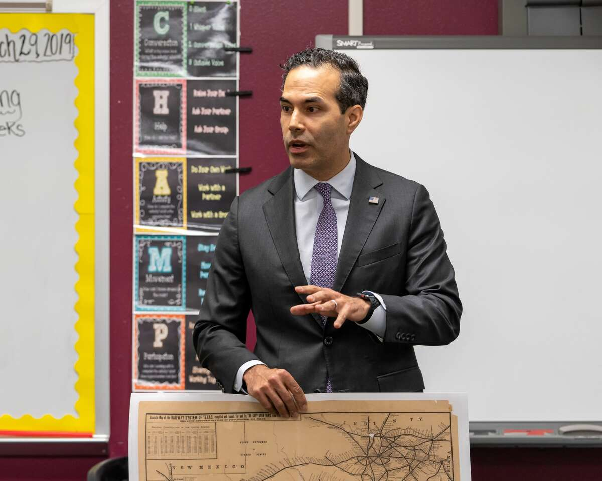 Texas Land Commissioner George P. Bush shows students a copy of a historic Texas map, which students used to delve into Texas history. Bush said the original map was discovered in a person's attic.