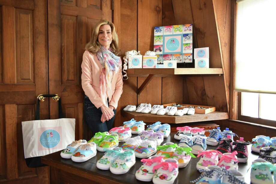 Westport resident Jane Garcin in March 2019 with handpainted baby shoes she sells under the SoleBaby brand. Photo: Alexander Soule / Hearst Connecticut Media / Stamford Advocate