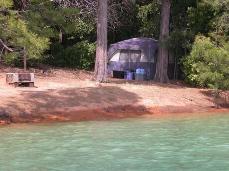 With Bullards Bar Reservoir 99 percent full, the water comes right up to the edge of the boat-in shoreline campsites. Photo: Tom Stienstra / The Chronicle