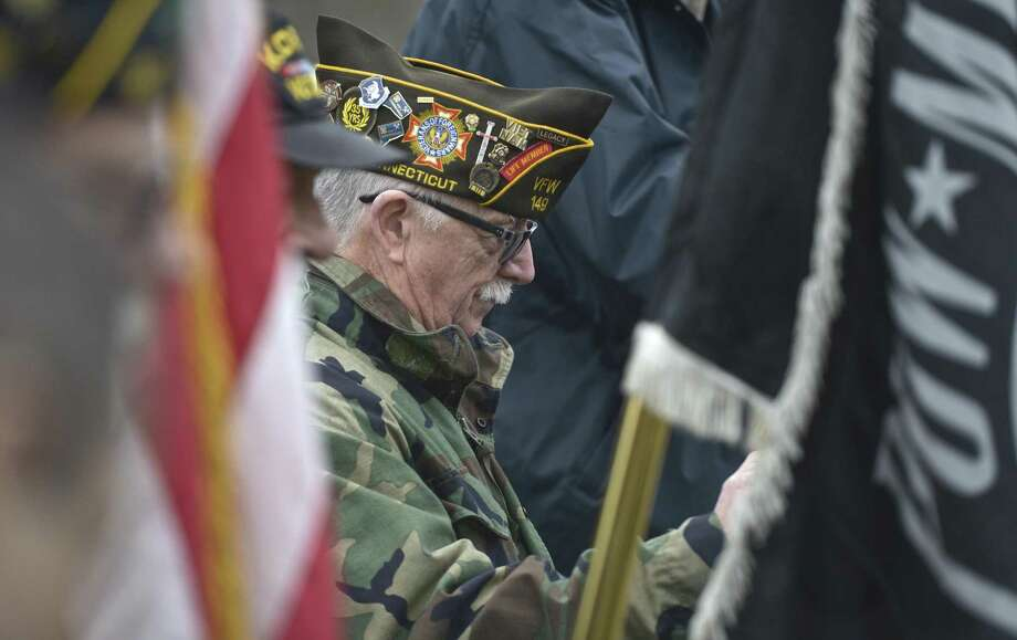 Paul Schlemmer, Commander of VFW post 149, bows his head during the invocation of the Veterans of Foreign Wars Raymond A. Walling Post 149 Vietnam War Veterans Day Services, held in Rogers Park at the Vietnam Monument on Friday, March 29, 2019, in Danbury, Conn. Photo: H John Voorhees III / Hearst Connecticut Media / The News-Times