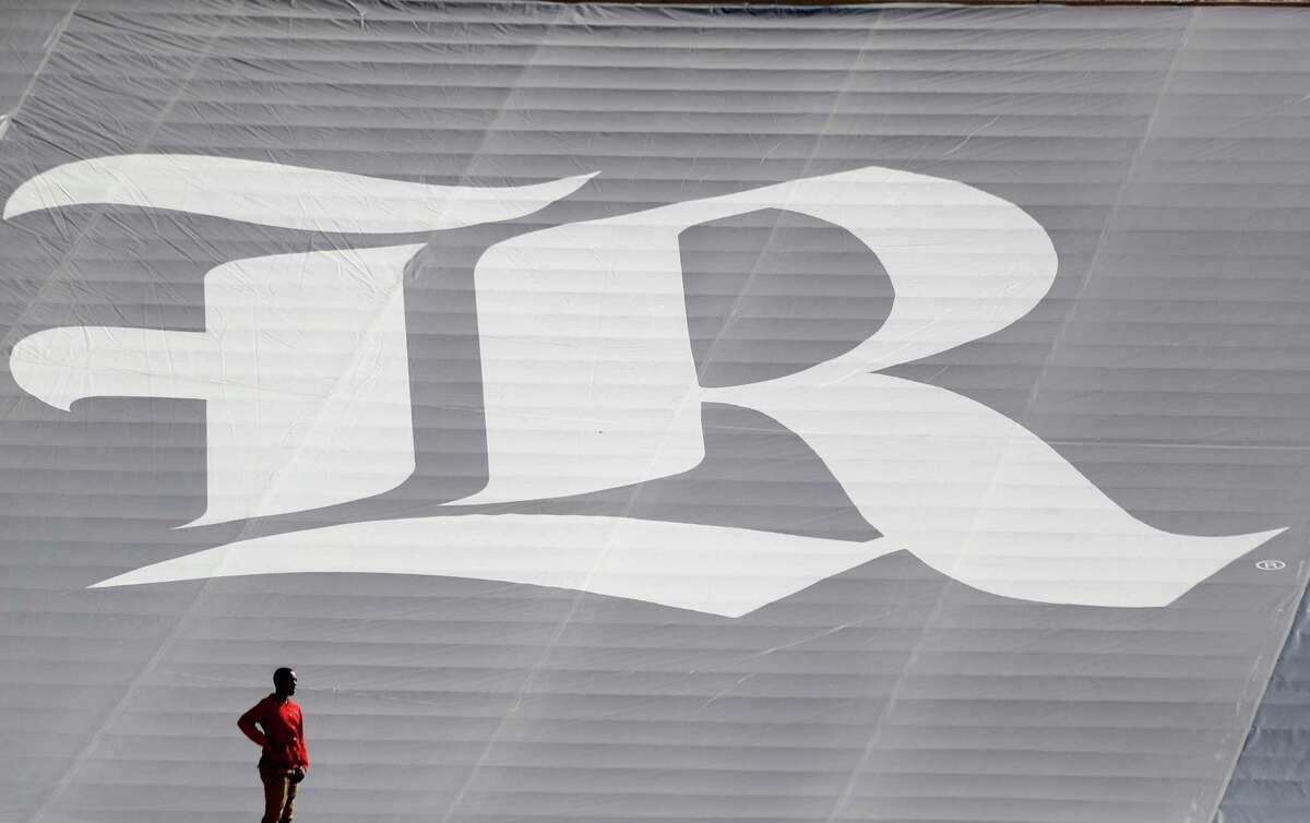 A man stands near the Rice Owls logo in the first half of a college football game at Rice Stadium, Saturday, Nov. 25, 2017, in Houston.