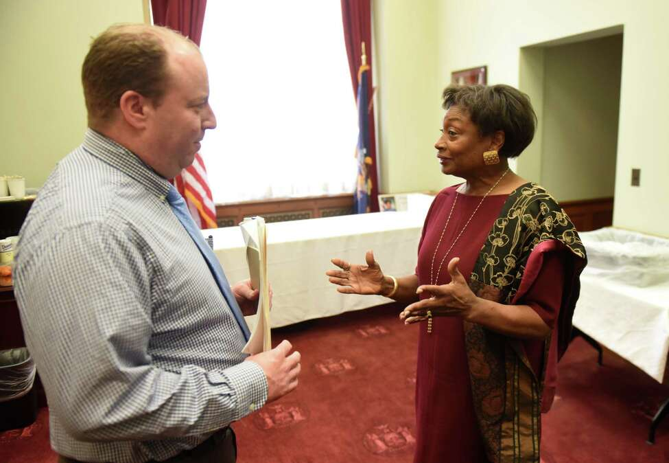 Senate Majority Leader Andrea Stewart-Cousins speaks with Senate Democratic communication director Mike Murphy, left, after holding a press conference where she spoke about state budget on Friday, March 29, 2019, in Albany, N.Y. (Will Waldron/Times Union)