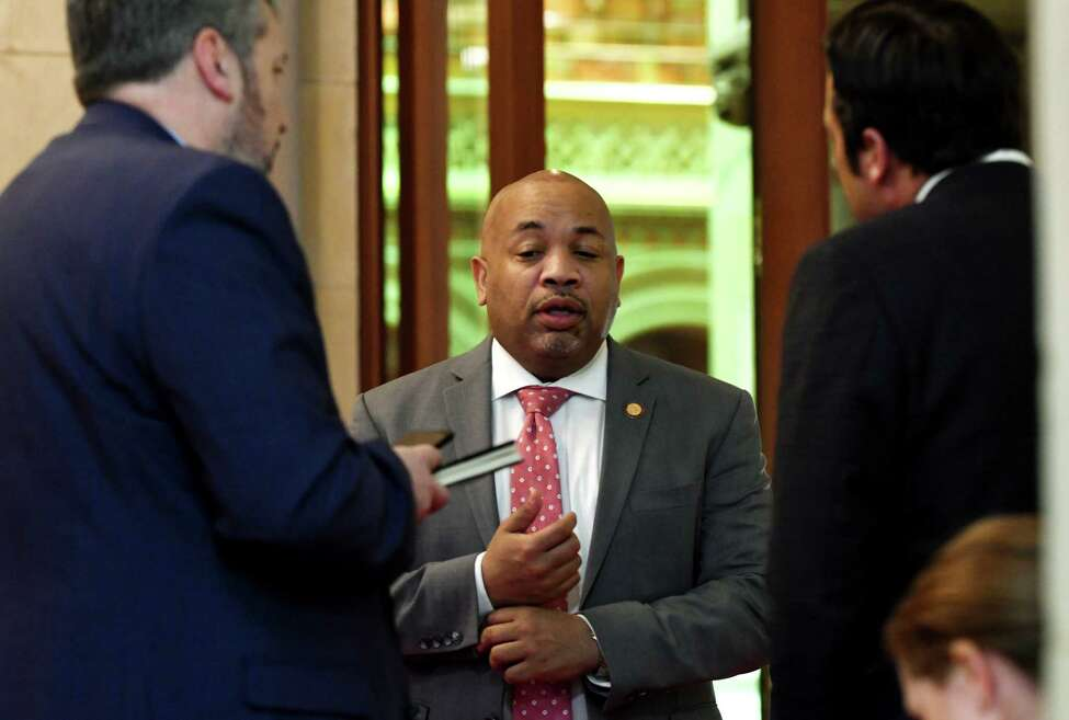 Assembly Speaker Carl Heastie, center, is joined by his communications director Mike whyland, left, while speaking to a reporter outside his Assembly office on Friday, March 29, 2019, at the Capitol in Albany, N.Y. (Will Waldron/Times Union)