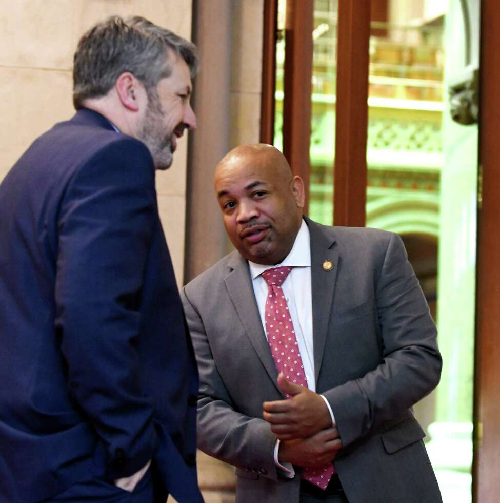 Assembly Speaker Carl Heastie, right, is joined by his communications director Mike whyland, left, while speaking to a reporter outside his Assembly office on Friday, March 29, 2019, at the Capitol in Albany, N.Y. (Will Waldron/Times Union)
