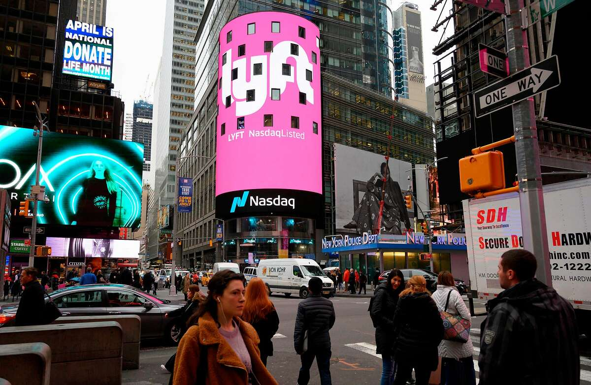 The Lyft logo is shown on the screen at the Nasdaq offices in Times Square on March 29, 2019 in New York. Nasdaq: LYFT, the multimodal transportation network, - Ride-hailing company Lyft made its Initial Public Offering (IPO) on the Nasdaq Stock Market on March 29. (Photo by Don Emmert / AFP)DON EMMERT/AFP/Getty Images