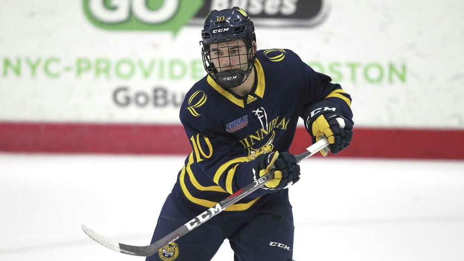 Quinnipiac's Ethan de Jong passes the puck during a game at Brown on Mar. 1 in Providence. Photo: Stew Milne / Associated Press / Copyright 2019 The Associated Press. All rights reserved.