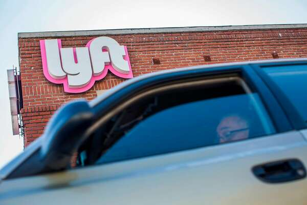 A driver rides his car in front of the Lyft Drivers Hub in Los Angeles, California, March 29, 2019. - Ride-hailing company Lyft made its Initial Public Offering (IPO) on the Nasdaq Stock Market on March 29th. (Photo by Apu Gomes / AFP)APU GOMES/AFP/Getty Images
