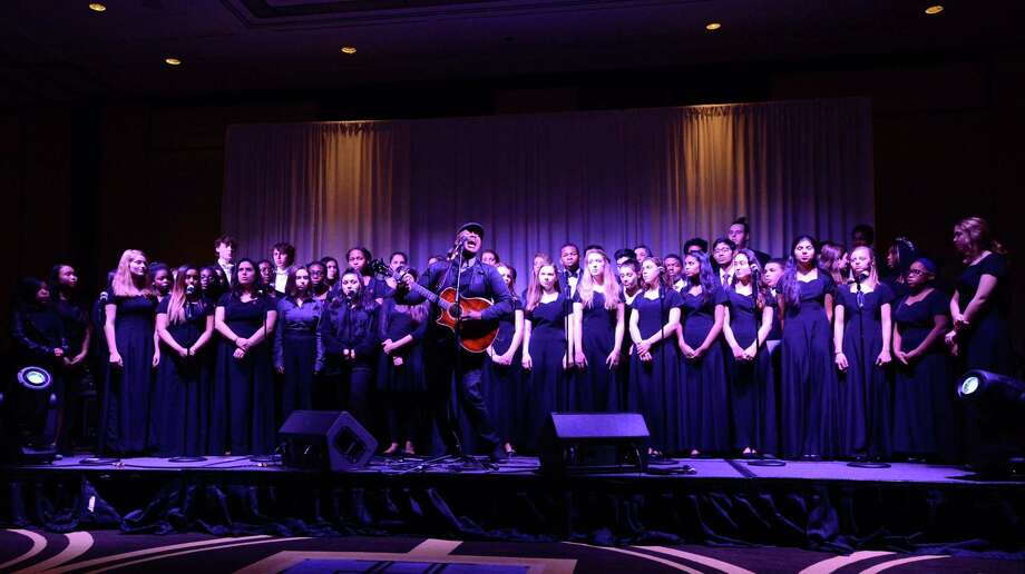 "Javier Colon, winner of The Voice, joins with the choral groups of Darien High School, Sacred Heart and Stamford High School to sing ""Hallelujah"" during the 10th Annual Pacific House ""Close to Home"" fundraiser at the Hyatt Regency Hotel on Friday, Feb. 23, 2018 in Greenwich, Connecticut. Pacific House will host a fundraiser in Stamford on April 4. Photo: Matthew Brown / Hearst Connecticut Media / Stamford Advocate"