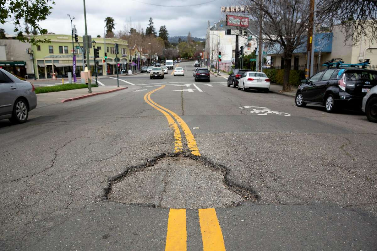 Potholes are seen on Park Blvd in Oakland, Calif. on Thursday, March 28, 2019.