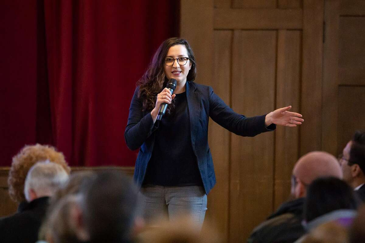 Sarah Fine, program manager for paving with the City of Oakland Department of Transportation addresses Oakland residents during a public hearing to discuss the three year Oakland Paving Plan followed by a Q&A for residents in Oakland, Calif. on Thursday, March 28, 2019.